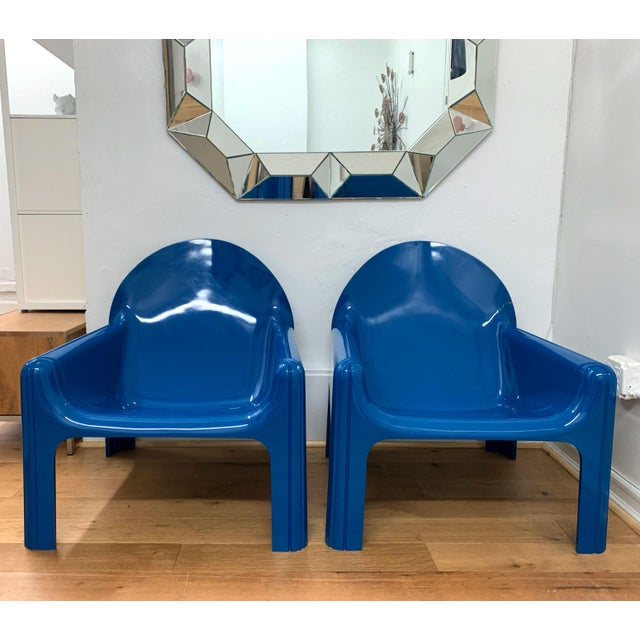 Rare pair of Italian lounge chairs 4795 by Gae Aulenti for Kartell, 1974. This is the version in blue which is hard to...