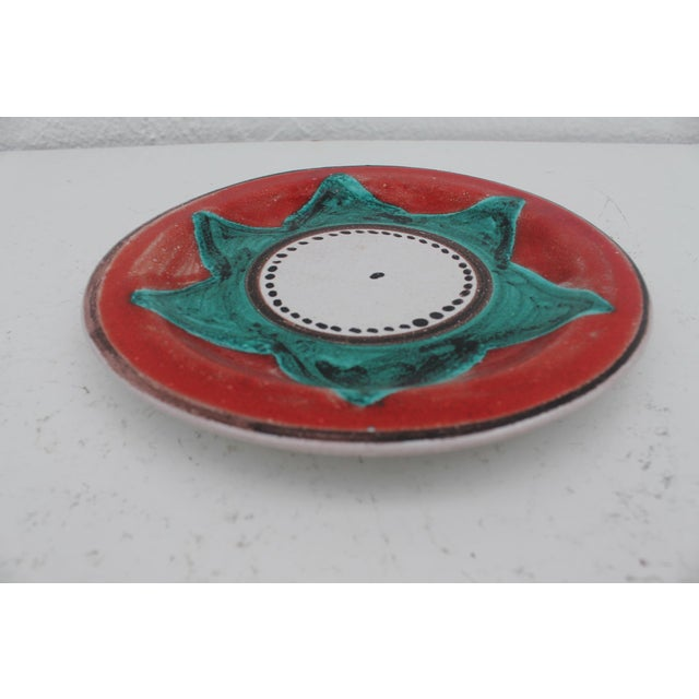 Vintage mid-century modern DESIMONE Italian pottery hand painted decorative plate . Signed on the bottom .