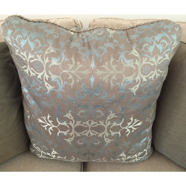 Three beautiful silk pillows in a jacquard fabric of browns, taupe and blue. Pillows are finished with a cord and have...