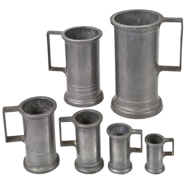 """Set of six vintage French pewter measuring mugs. Maker's mark on bottom of each. Sizes range from 2 1/4""""h x 1 3/4""""w x 1..."""