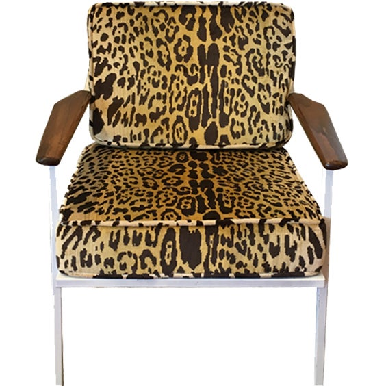 A lovely mid-century chair upholstered in Scalamandre's leopard print. Lovely walnut arms and white body. Body is vintage...