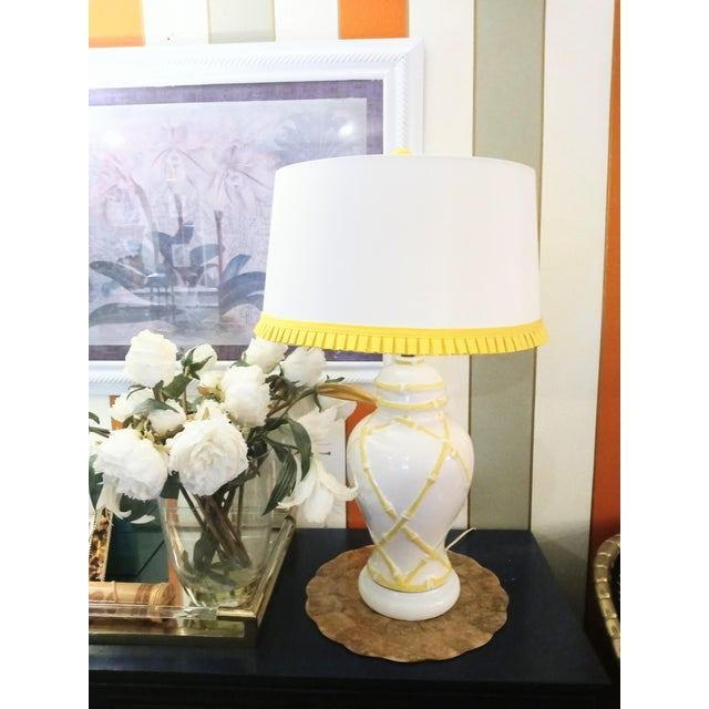 A gorgeous vintage ginger jar lamp with the sweetest yellow faux bamboo design and custom trimmed yellow pleated matching...