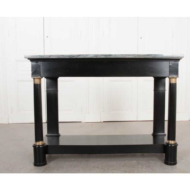 Refine your living space with this smart and sophisticated Empire-style ebonized and ormolu-mounted console and mirror...