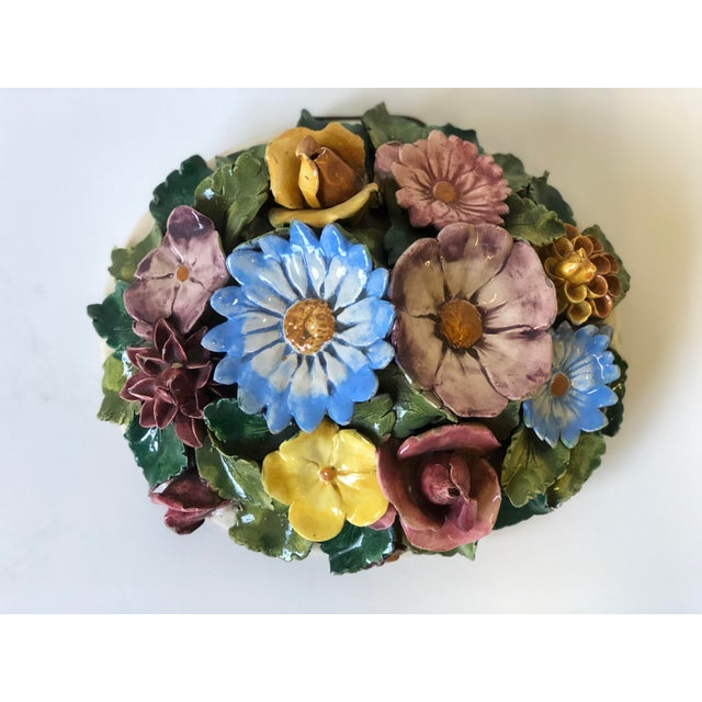 This charming and beautifully detailed floral ceramic piece is wired as a wall mount, but can also lay flat as a table...