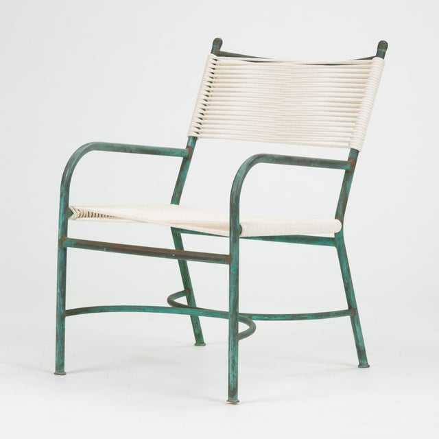 An early California-made bronze patio lounge chair by Walter Lamb antecedent, Robert Lewis. The bronze tubing in this...