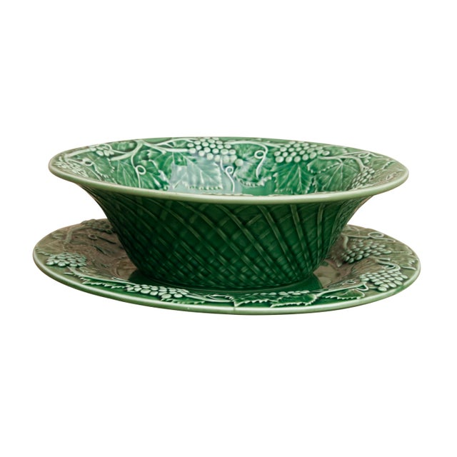A matching ceramic bowl and serving plate in emerald green made by Bordallo Pinheiro of Portugal. The rim of the bowl and...