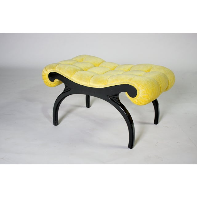 1940's Hollywood Regency bench by Grosfeld House in tufted yellow velvet and sculptural ebony wood legs.