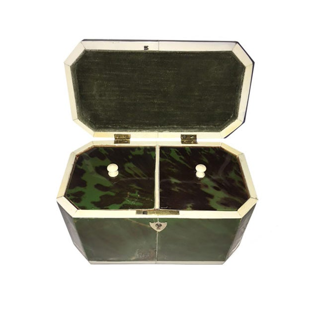 A rectangular form faux green tortoiseshell and bone tea caddy with canted corners. The interior with two lidded...