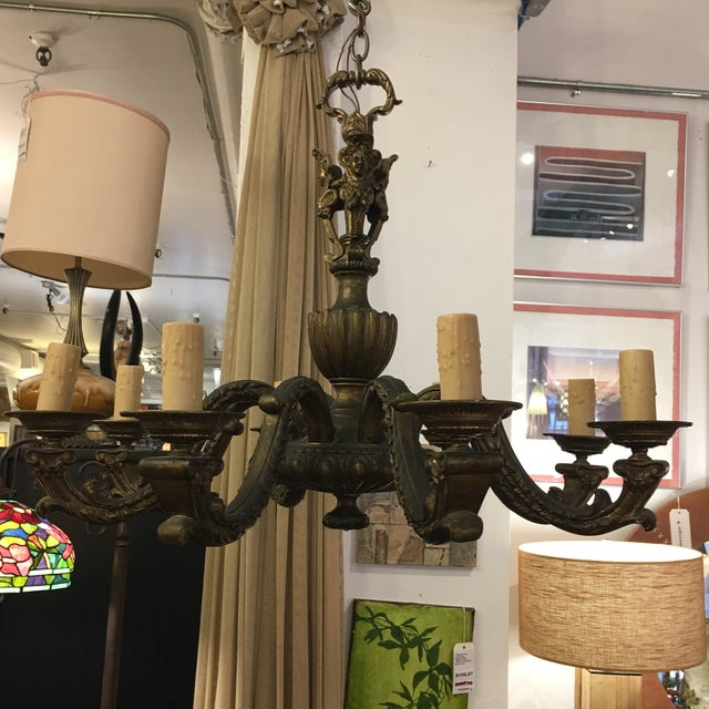 Design Plus Gallery has an Eight Light Antique Chandelier. This beautiful fixture is a 100 years old. This Chandelier is...