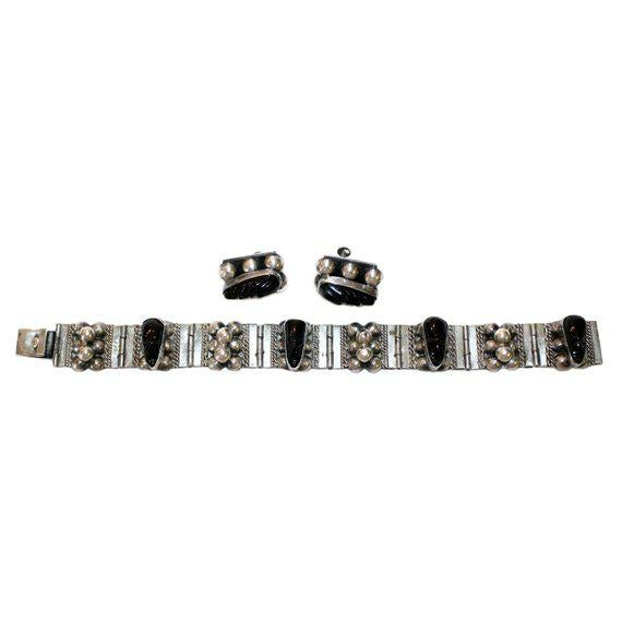 Wonderful vintage c.1940's Mexican sterling silver bracelet and screw back earrings, bezel set with black onyx masks and a...
