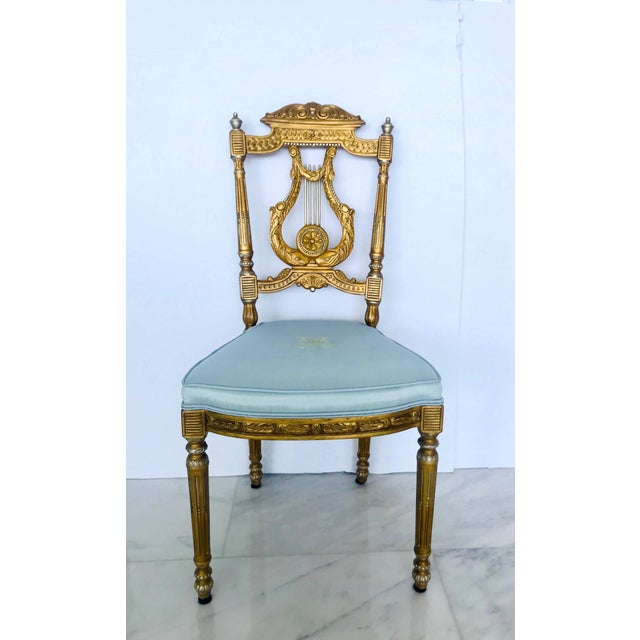 Beautiful salon chair or accent chair with Neoclassical designs. Made of hand carved wood finished in antique gold leaf...