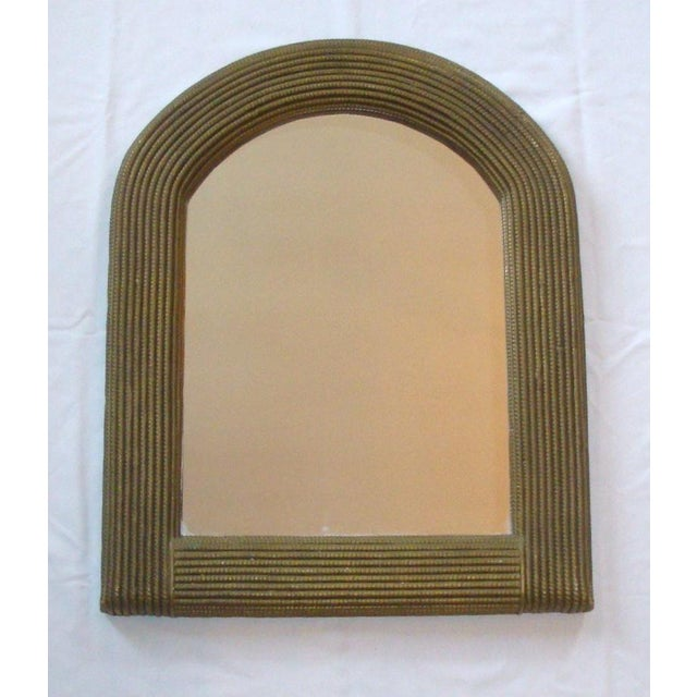 Unusual vintage wrapped wicker or rattan mirror, circa 1960-70s, marked Culver City, CA (Los Angeles). Suited to eclectic,...