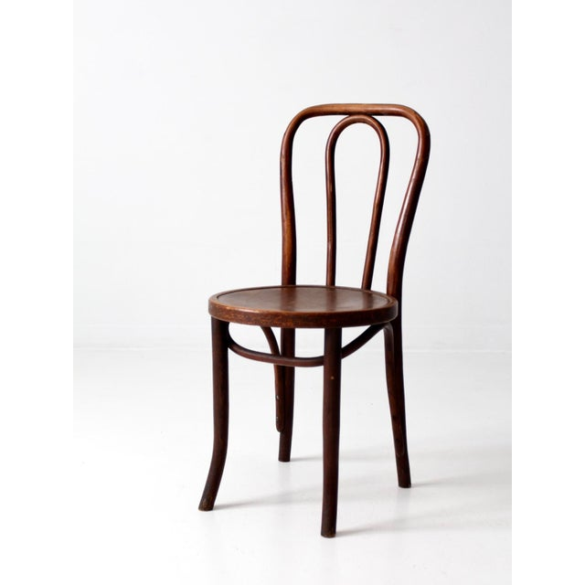This is an antique bentwood chair. The Thonet style cafe chair features  classic curving lines - Antique Bentwood Chair Chairish