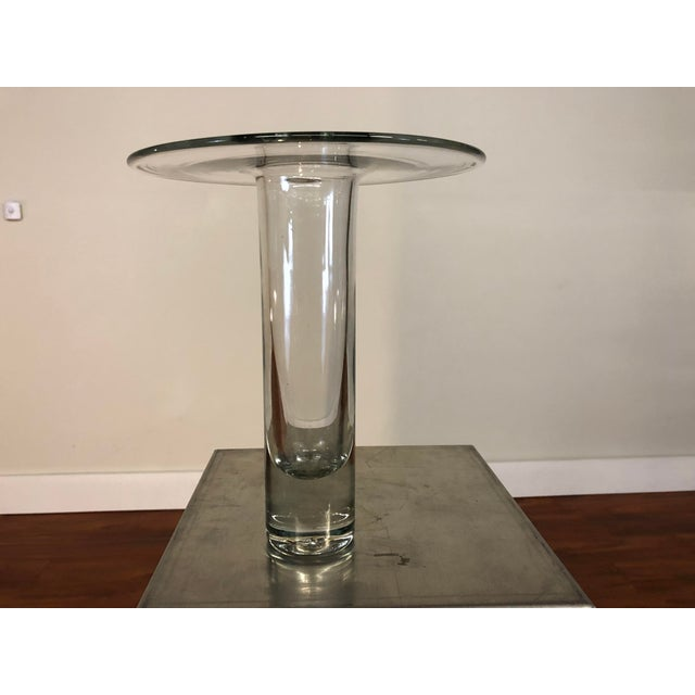 This is a beautiful hand blown modern glass vase made out of simple and elegant geometric forms. The vase can blend into a...