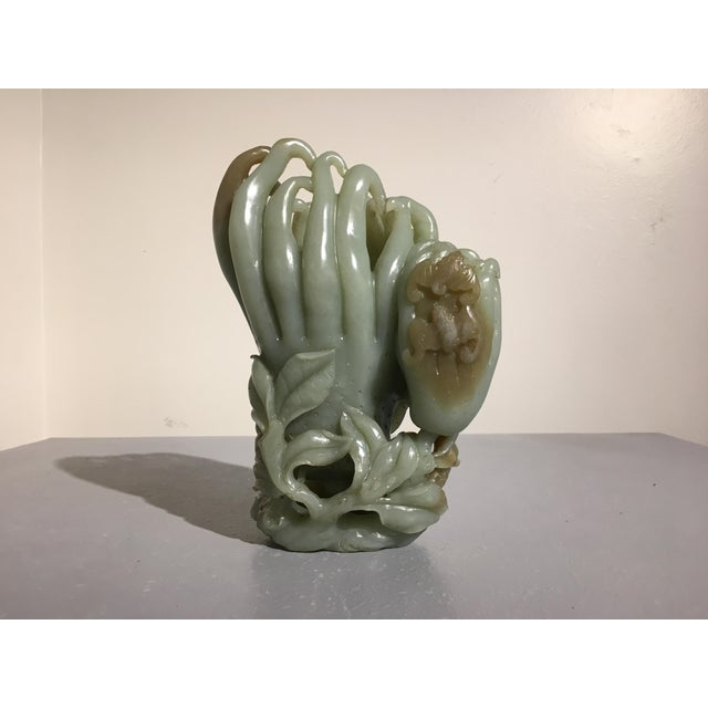 A large, late Qing Dynasty Chinese carved jade Buddhas Hand double vase. Carved from a single piece of jade, the vase...