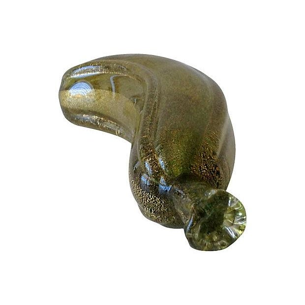 Vintage Archimede Seguso Italian Murano hand blown banana, green with gold dust flecks, and clear outer casing. Tip or end...