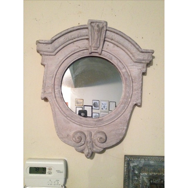 Great in small spaces! This architectural style mirror, in a light gray color, will definitely update any room.