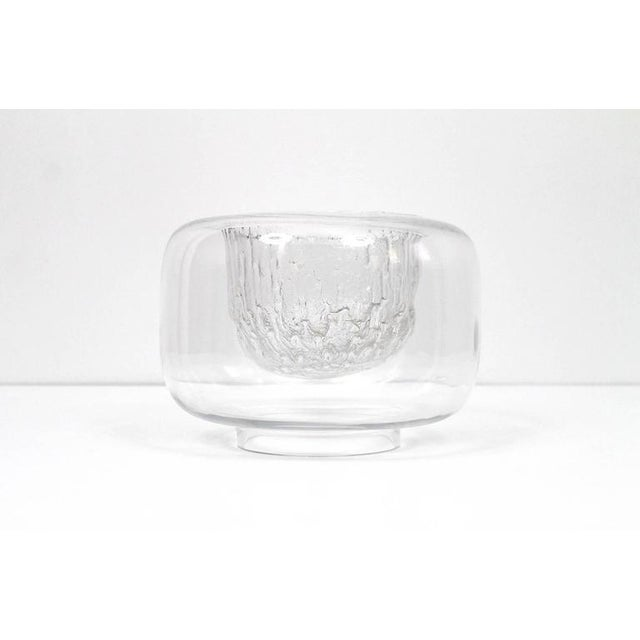 "Timo Sarpaneva for Iittala glass bowl from the ""Finlandia"" line. Each of these bowls was blown around a charred stump of..."
