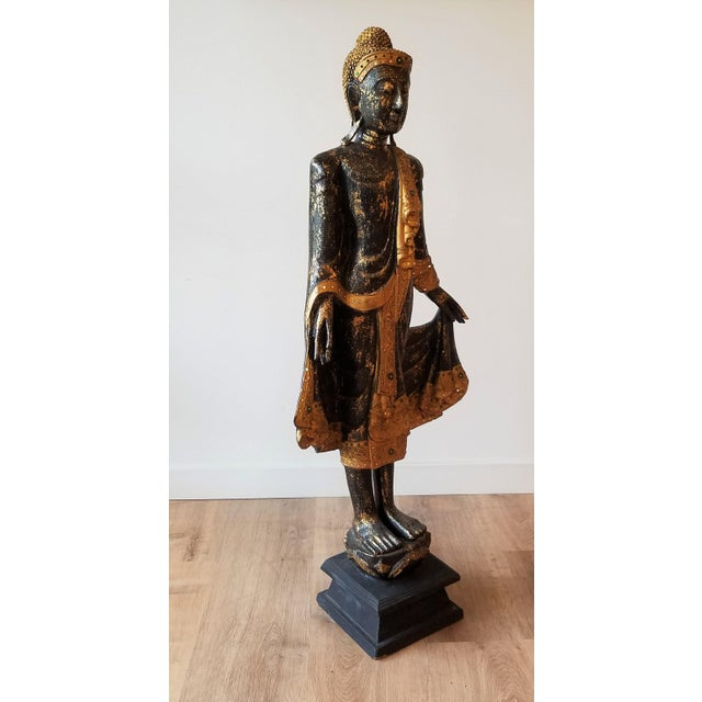 This hand sculpted and painted buddha stands almost 4 feet tall. There is a stunning amount of detail from the head to the...