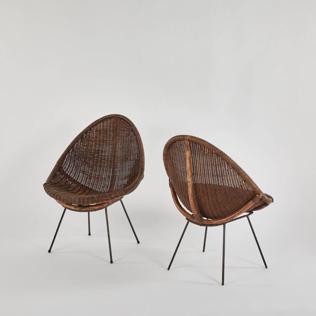 Pair of mid-century bamboo and rattan chairs from France.