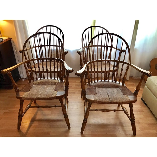 Beautiful Windsor Arm Chairs circa 1920's from Barnard & Simonds with hand wrapped rush seats & Carved Knuckle Handhold on...