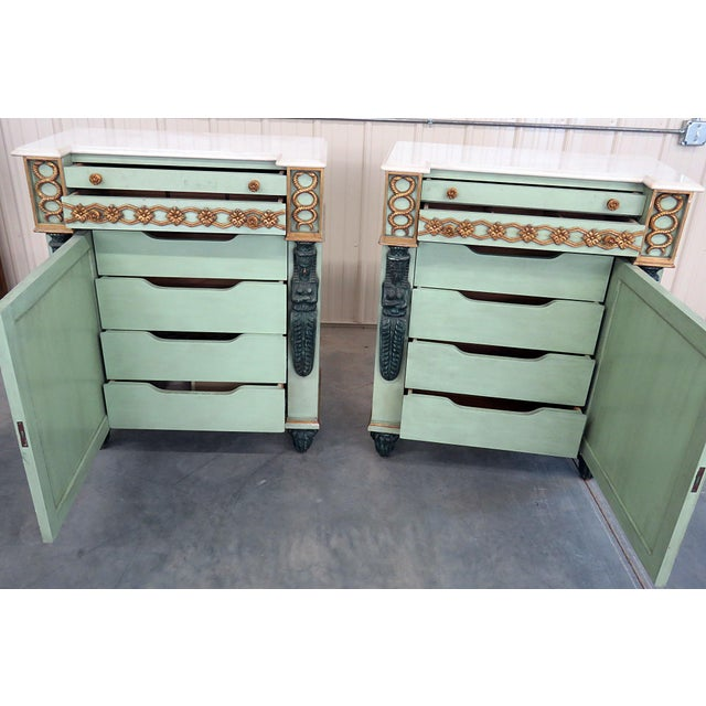 Pair of Empire style distressed painted commodes with 2 doors over 1 door containing 4 drawers.