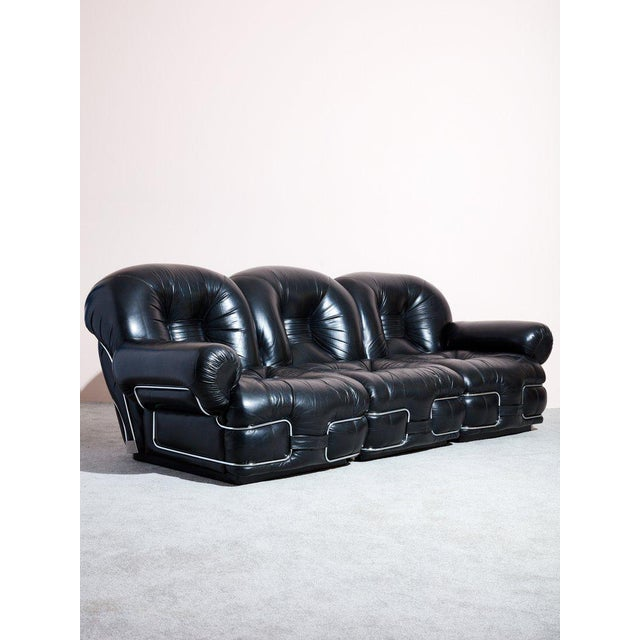 Vintage circa 1970s Italian leather sofa. Impressive detailed black leather upholstery and chrome structures. Beautiful...