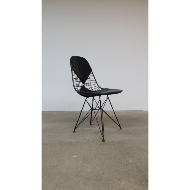 """An early Charles and Ray Eames designed """"DKR-2"""" (dining height , k-wire shell, rod base, bikini pad), designed circa 1952..."""
