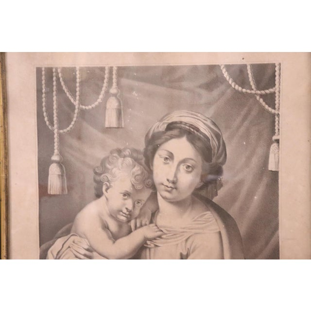 Beautiful religious collectible lithograph print. It represents an image of Madonna with Child, circa 1880s with wooden...