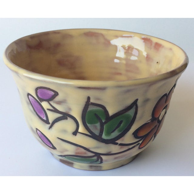 Handcrafted, hand painted French midcentury ceramic bowl. Beautifully decorated with floral designs and glazed. Signed on...
