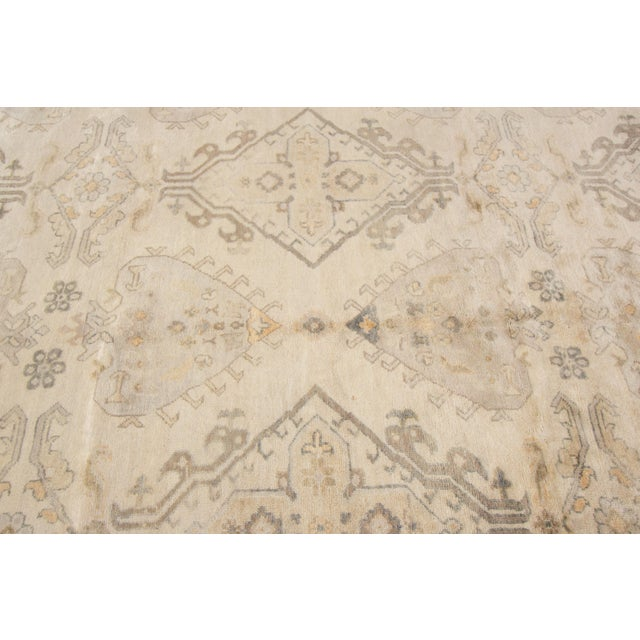 Vintage hand-knotted Oushak rug with an all-over design in ivory. This rug has a great color to go with its highly...