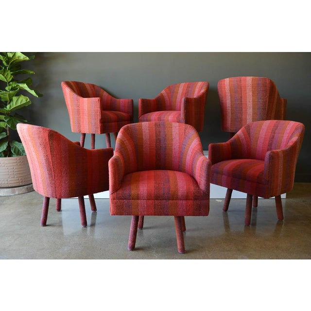 Swivel armchairs with vintage Jack Lenor Larsen Fabric, circa 1970. Beautiful vintage magenta wool stripe tweed with...