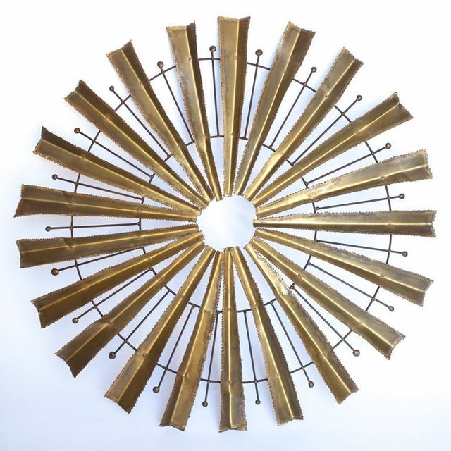 Rough edges, raw materials, and minimal embellishments give this wall art the harsh edge of Brutalist style. Made of brass...