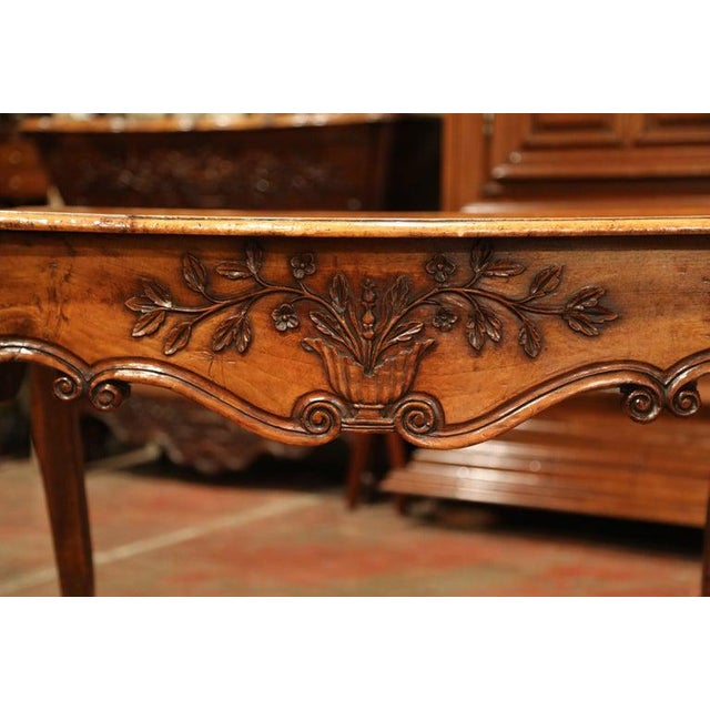 Decorate a bedroom or a living room with this elegant antique fruitwood table. Created in Southern France circa 1760, the...
