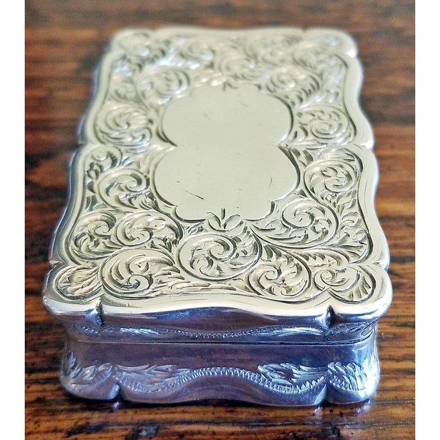 Lovely little sterling silver snuffbox, fully hallmarked with gold plated interior. Lovely chasing on lid and sides,...