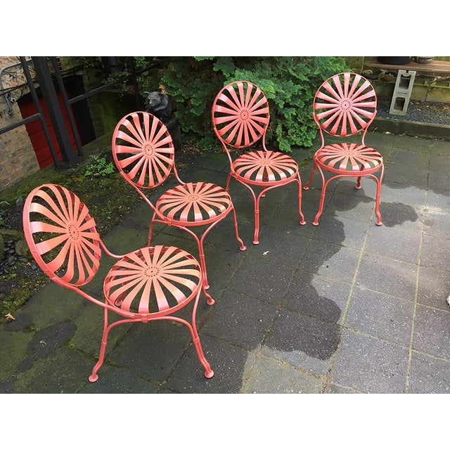 """Vintage Carré patio set of four side chairs and a 42"""" round table in excellent condition. Designed by Francois Carré in..."""