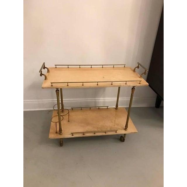 Aldo tura parchment bar cart. Having beautiful brass hardware.