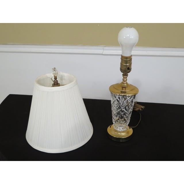Small Waterford crystal table lamp with shade. Features high quality construction. Signed crystal. Excellent condition....