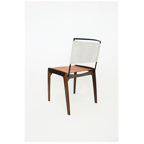 The LD is Fluxco Design's dining chair option. The legs are shaped from solid walnut and a leather sling is mounted to...