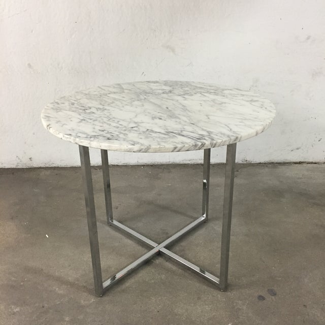 This marble table is gorgeous! Every slab of marble is unique and I particularly love this cut. There is a small chip on...