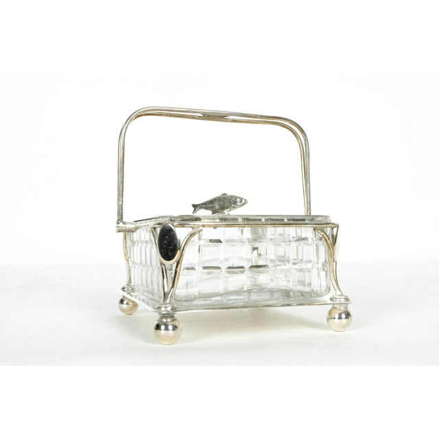 Old English silver plated holding carrier with cut crystal caviar dish. All in excellent condition. The caviar holding...