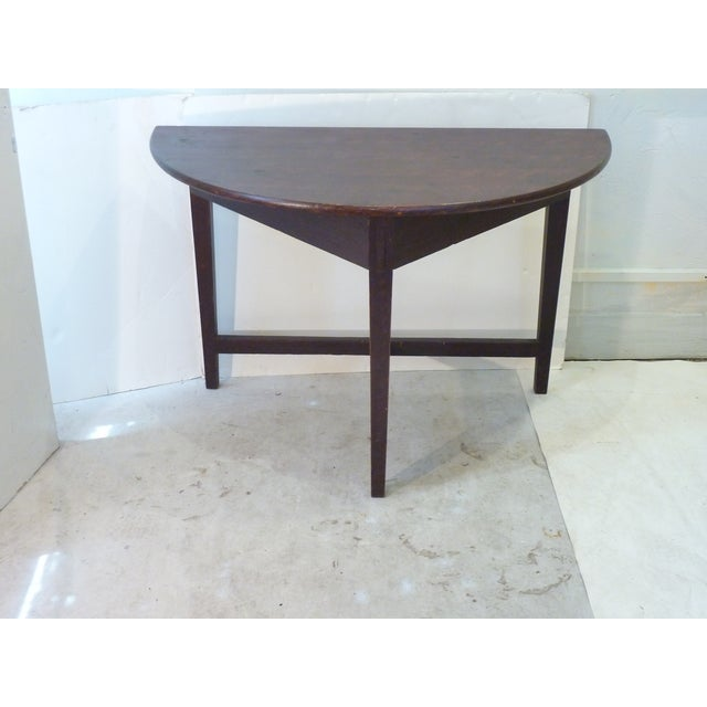 Early American grain-painted demi-lune table skilfully pegged and joined construction, sturdy.