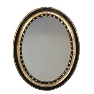 Irish Oval Mirror With Moulded Parcel-Gilded and Ebonized Frame, Applied With Mirrored Glass Facets, Circa 1890 For Sale