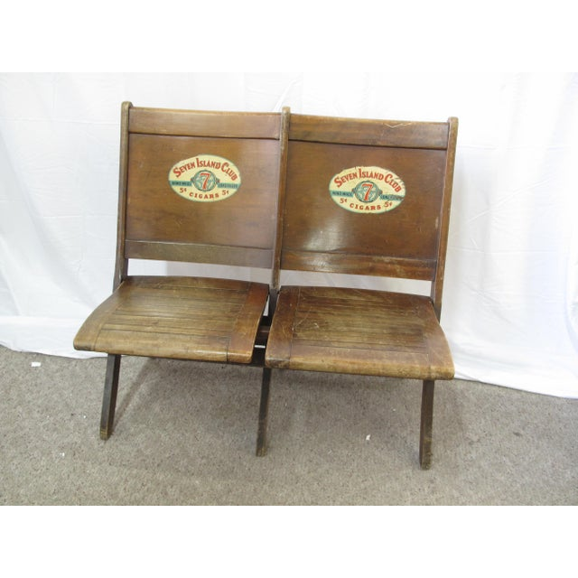 Unusual light yet masculine folding double bench from the late 1930's or early 1940's. Made of wood but bearing decal...
