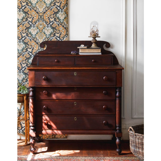This dresser has a few stories to tell. After all, it's been around for over a hundred years. The character of the wood is...