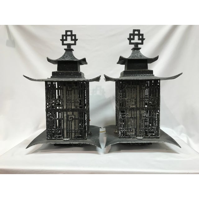 Fantastic Asian outdoor lighting came from an estate as the entire estate was of this decor. Constructor of molded metal...