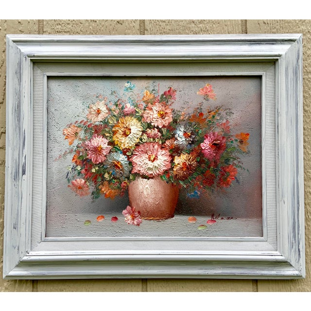 Impasto style vintage floral still life. This is an original oil painting, in its original frame, with the signature...