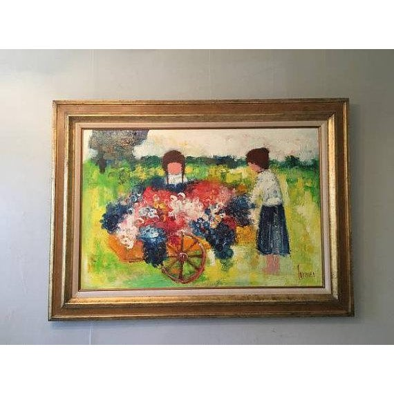 """A large oil painting by Christian Lanier, professionally framed, and depicting two girls with a flower cart. 44.5x32.5""""..."""