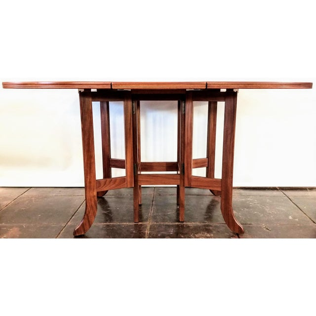 Parker Knoll labeled drop-leaf gate-leg occasional and dining table is in clean, fine condition and ready for placement in...
