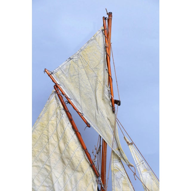 An antique 19th-Century English pond yacht schooner with 2 original canvas foresails and rigging. The hull retains...